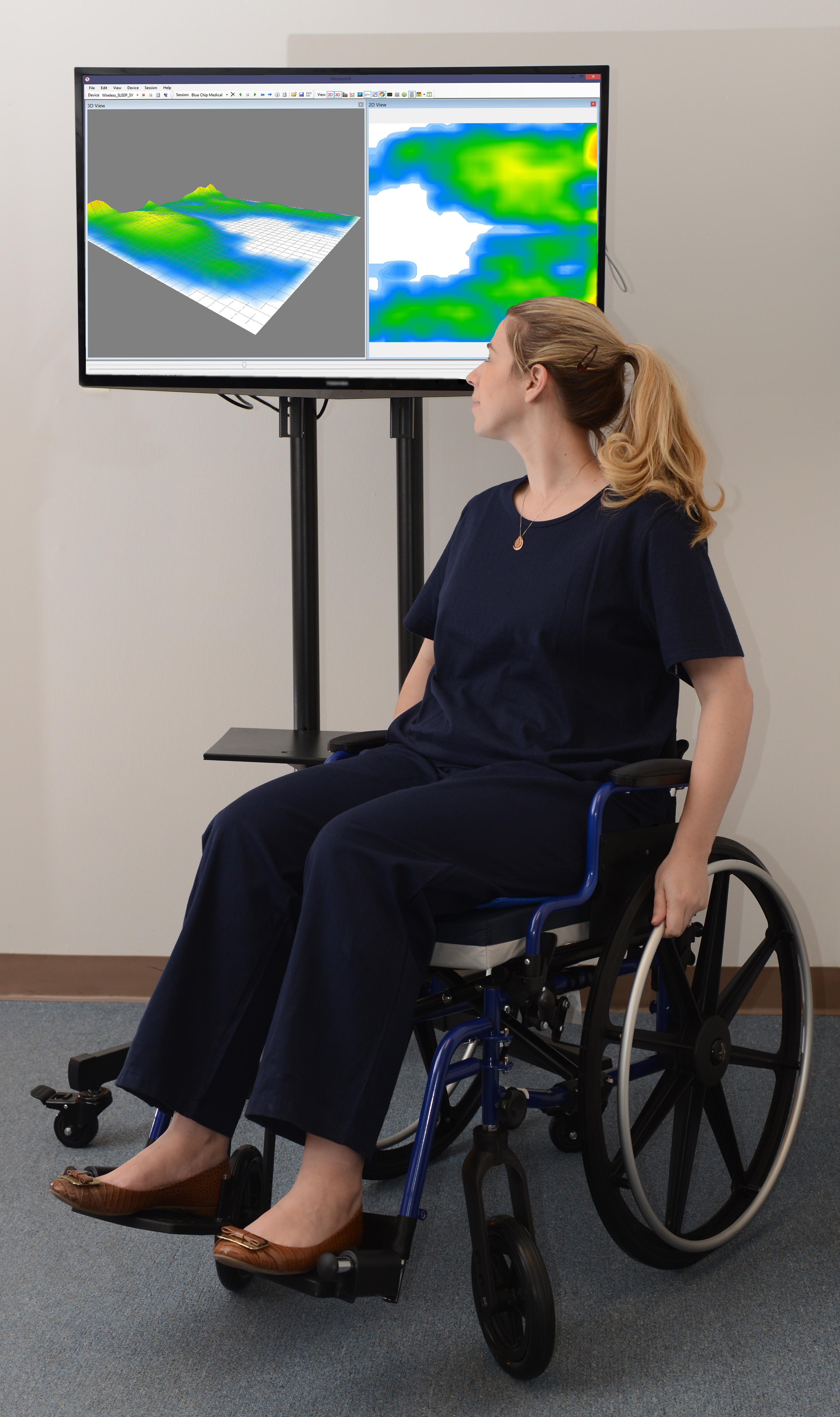 Woman sitting on sensor                  and looking at results